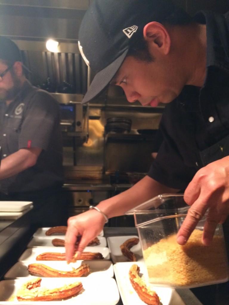 Rostizado's chef Edgar Gutierrez plates dessert at Swine & Dine
