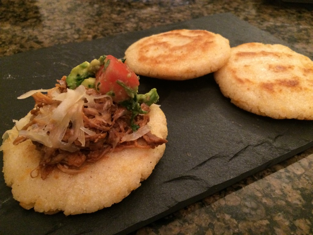 pulled pork topped arepas